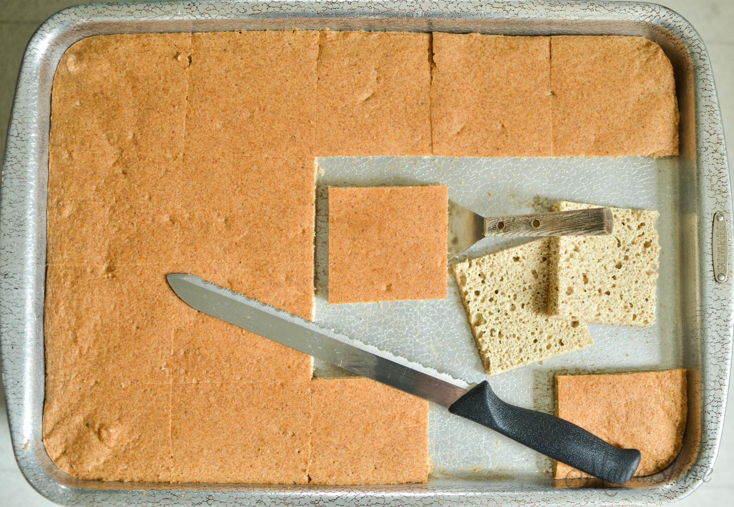 Gluten-Free Bread cut into squares with bread knife.
