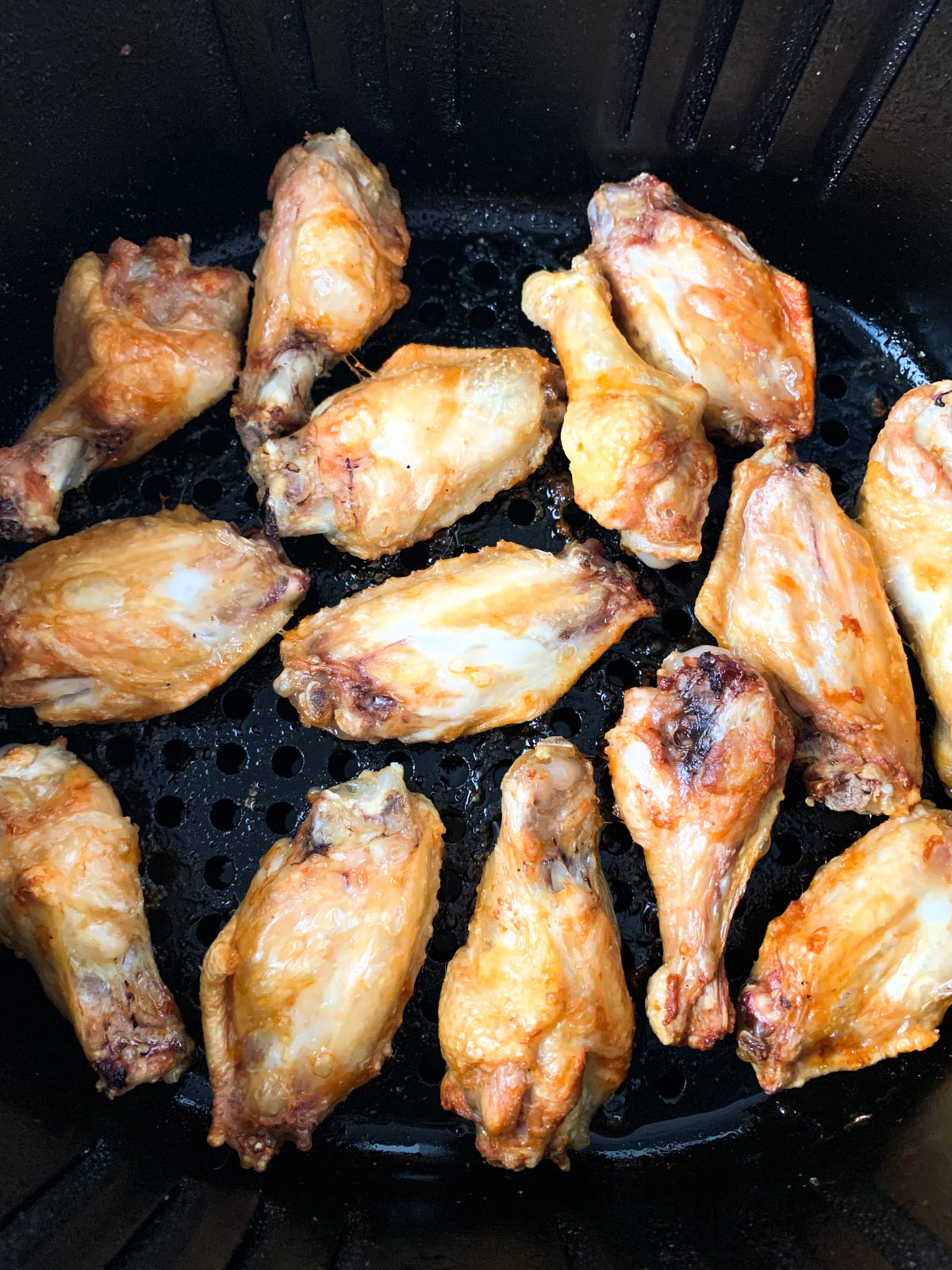Chicken wings fried in an air fryer.