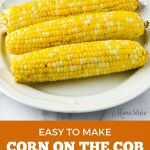 Cooked corn on the cob on a white serving plate.