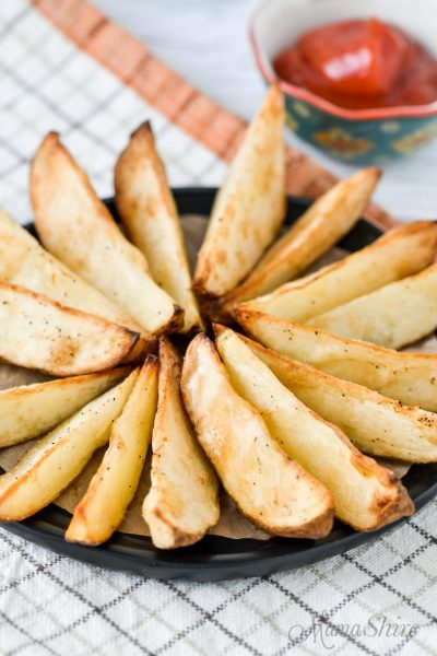 A plate of potato wedges made in an air fryer.