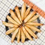 A plate of air fryer potato wedges.