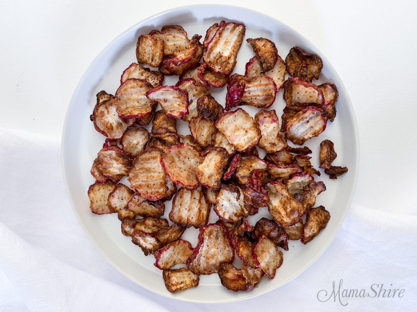 A plate of Low Carb Air Fryer Radish Chips for snacking.