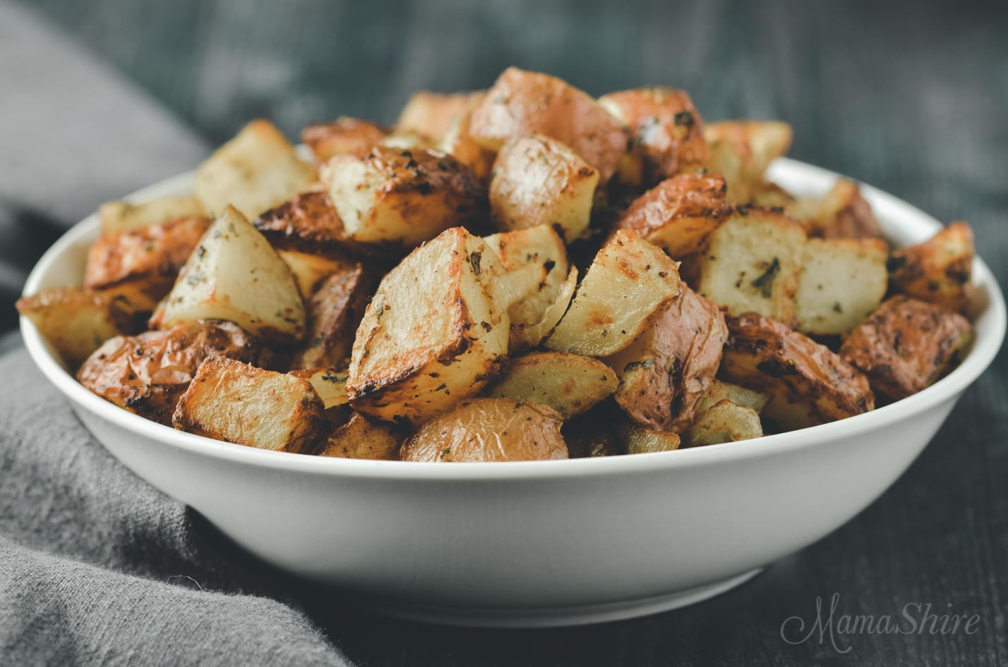 Air Fryer Red Potatoes Roasted with Parsley in a white serving bowl.