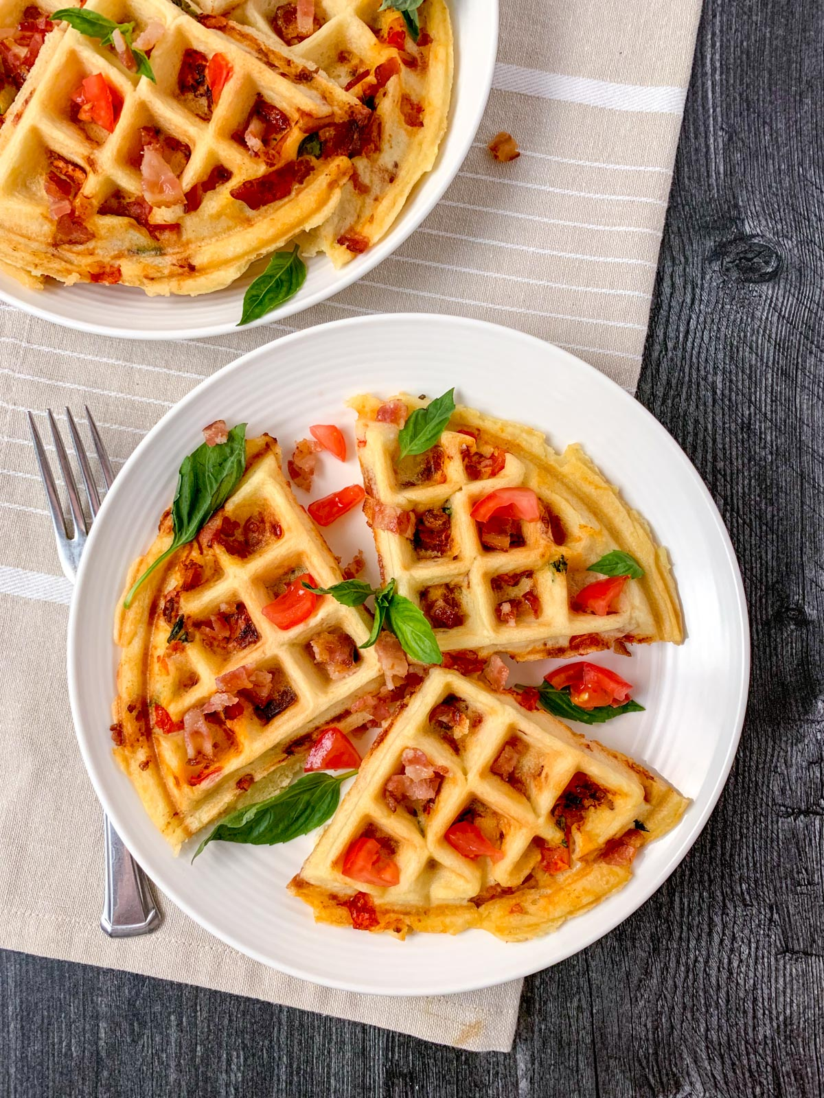 Savory waffles stuffed with bacon and tomatoes.