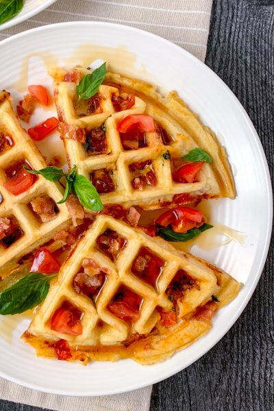 A drizzle of maple syrup over the gluten-free stuffed waffles.