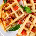 Gluten-free stuffed waffles with bacon and tomatoes.