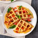 Savory bacon tomato stuffed waffles with a gluten-free and dairy-free batter.