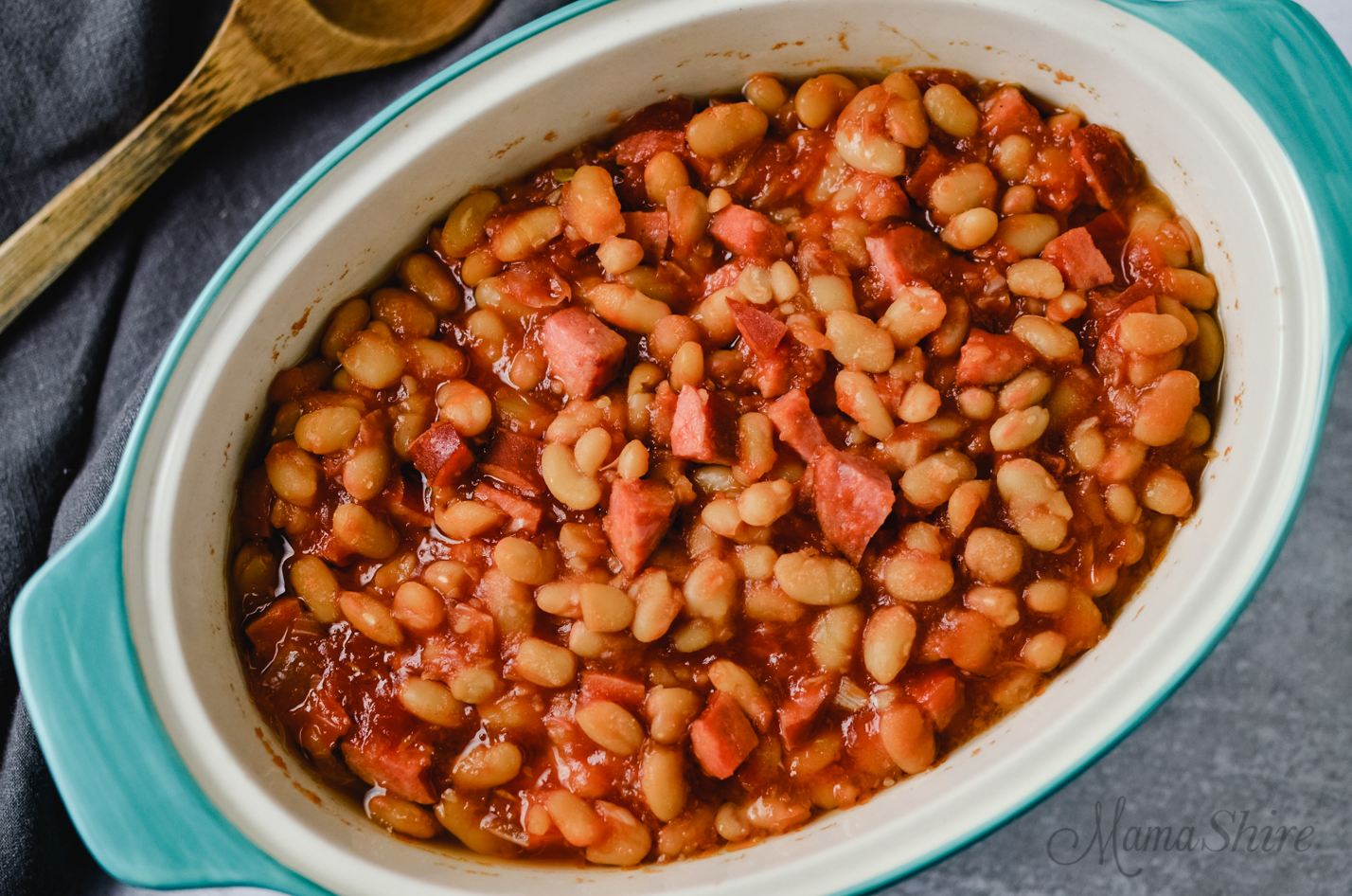 Baked beans in a casserole dish.