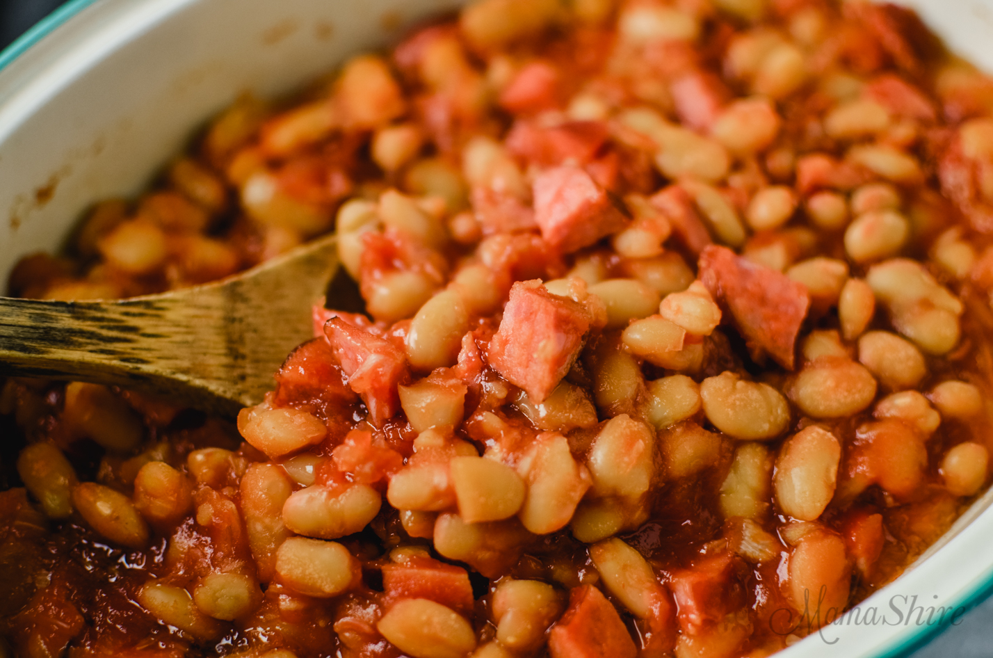 Baked beans made with brown sugar and smoked sausage.