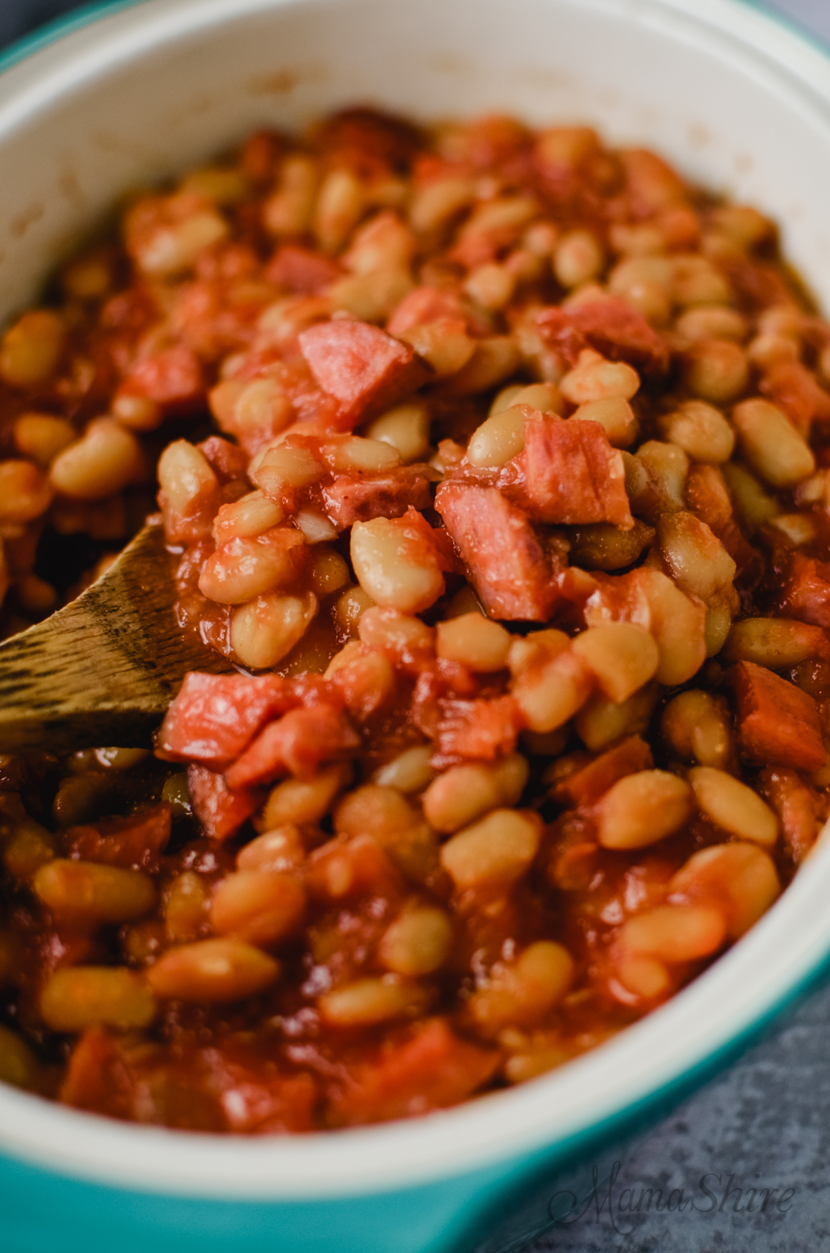 Baked beans with smoked sausage and brown sugar.