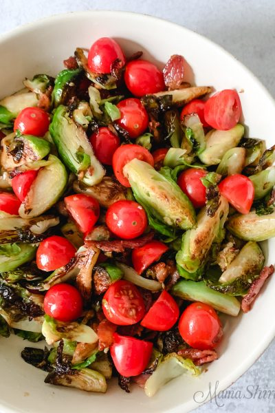 Sauteed Brussels Sprouts with Bacon and Tomatoes.