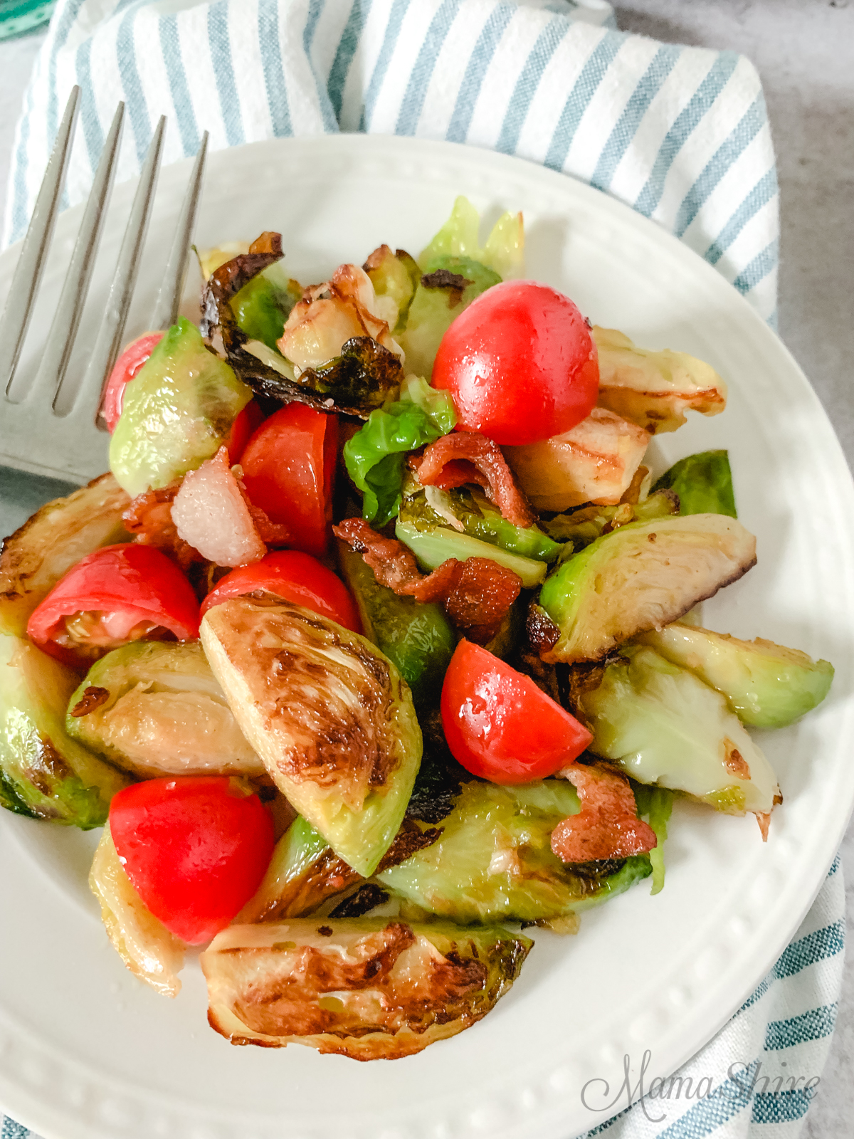 A plate of Brussels sprouts with bacon and tomatoes that tastes like a BLT.
