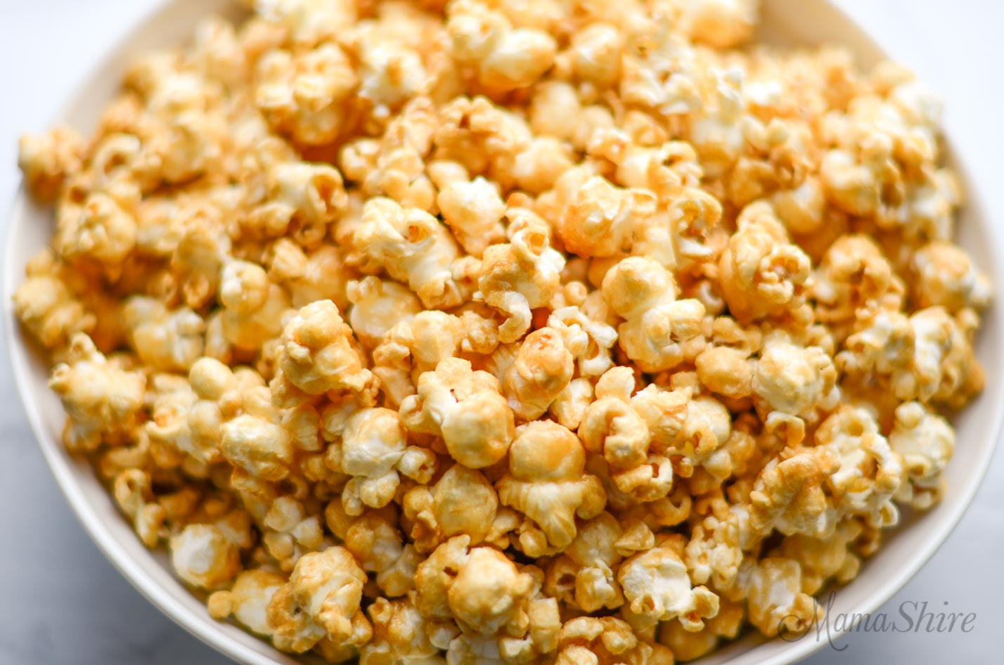 A big bowl of homemade caramel corn without corn syrup.