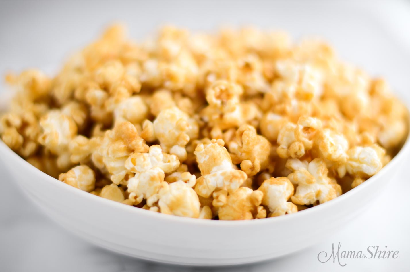 A bowl of homemade caramel corn made without corn syrup.
