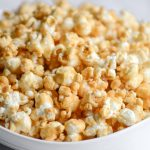 A bowl of homemade caramel corn made without corn syrup and dairy-free.