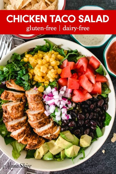 Healthy Chicken Taco Salad with black beans, corn, avocados, and tomatoes.