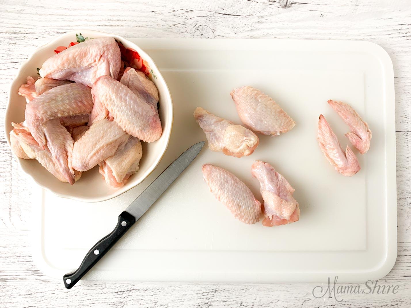 Chicken wings cut into three pieces.