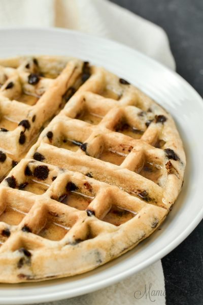 Chocolate chip waffles with syrup.