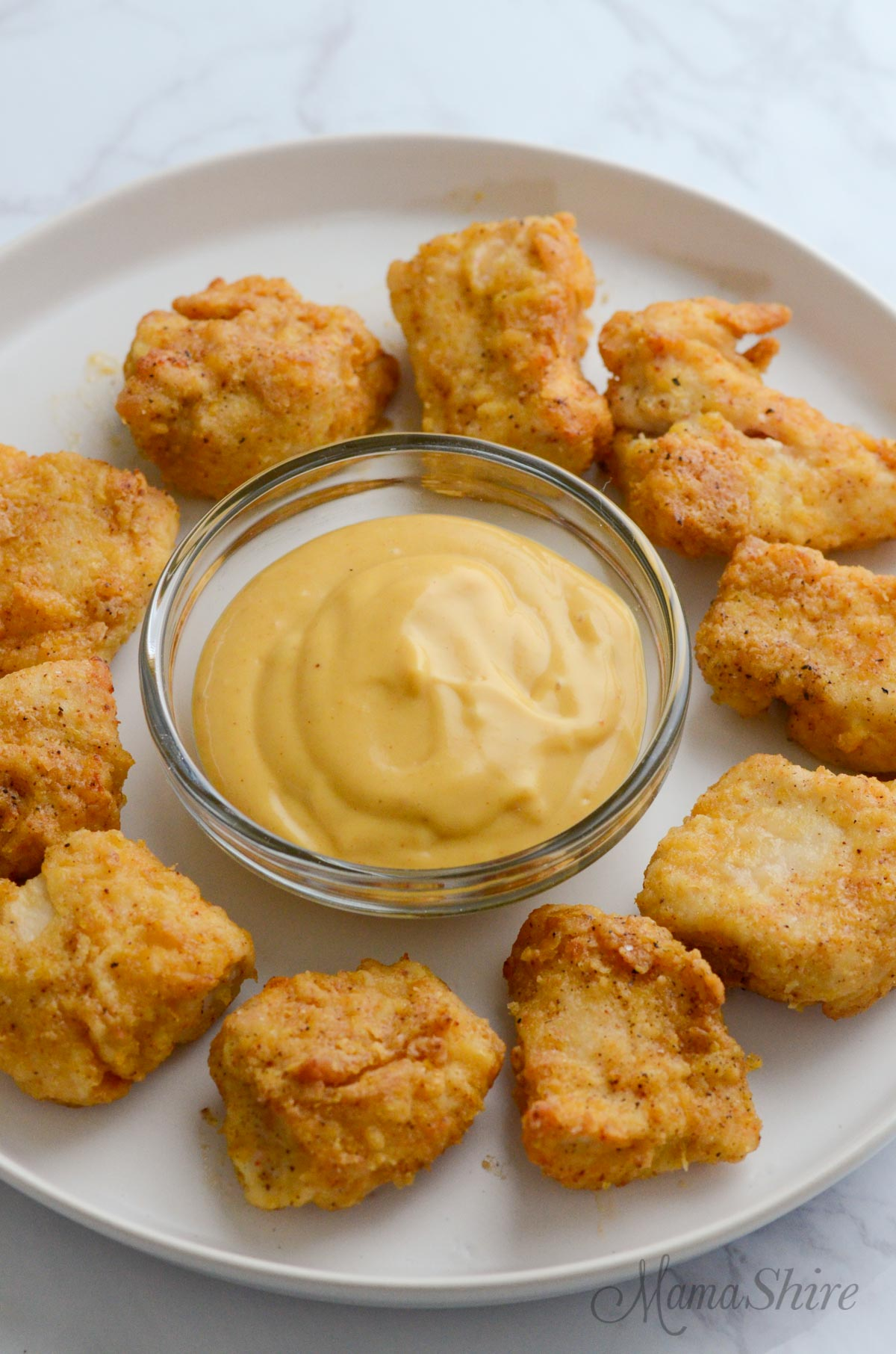 Homemade Chick-Fil-A Sauce with gluten-free chicken nuggets.