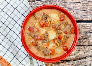 Creamy hamburger soup with tomatoes, potatoes, creamed corn, and coconut milk.