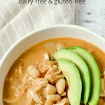 White Chicken Chili with sliced avocados