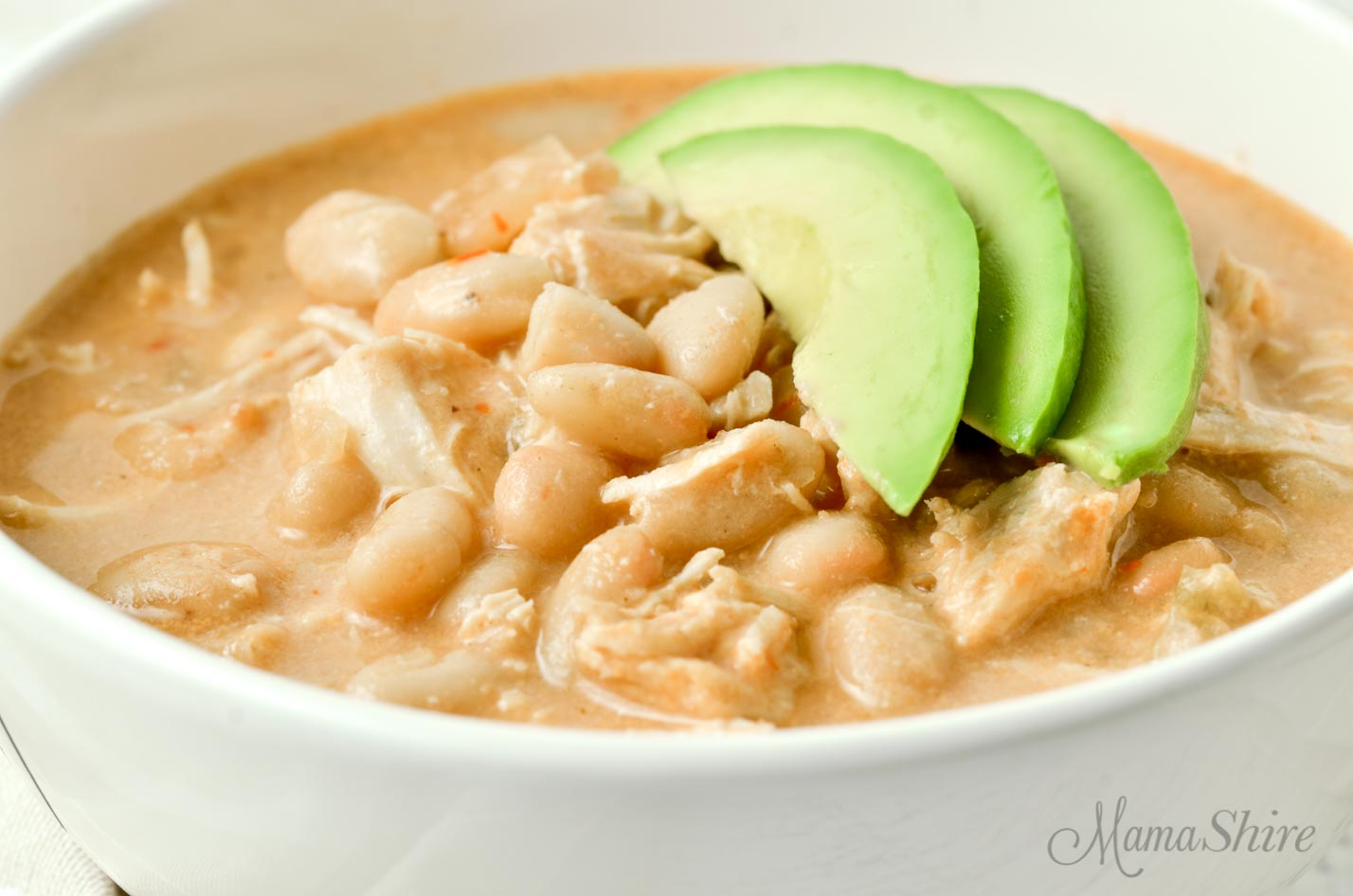 White Chicken Chili with avocado slices