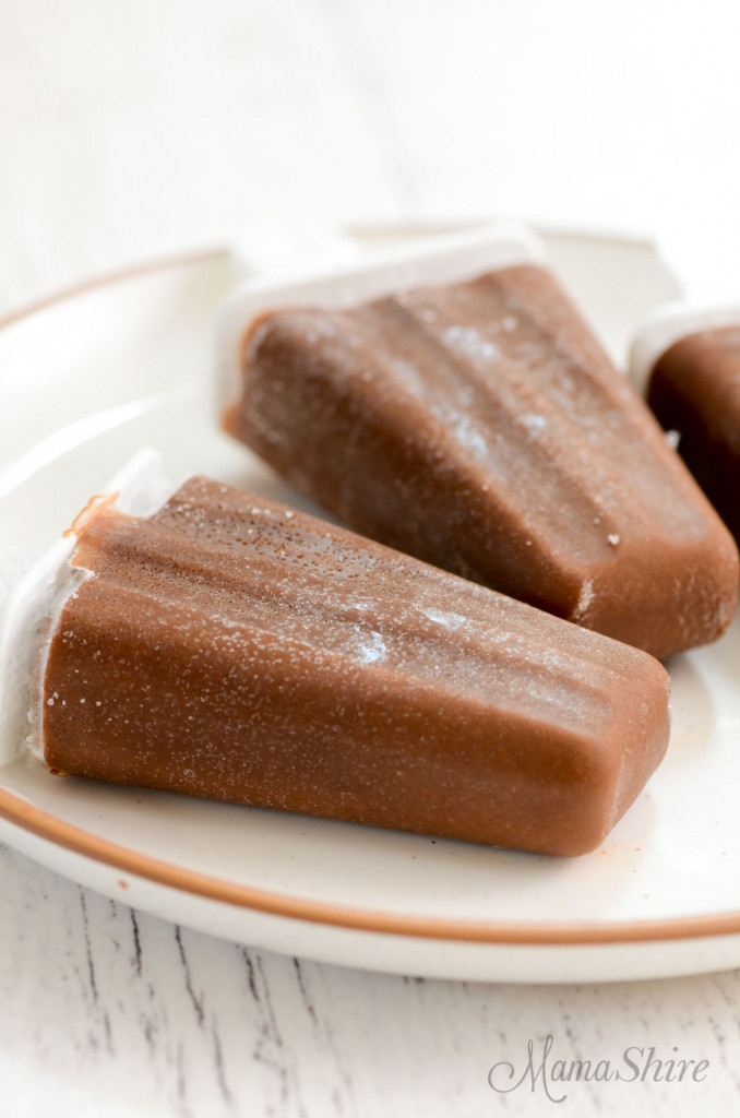 A plate with homemade dairy-free fudgesicles on it.