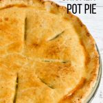 A chicken pot pie with a flaky pie crust.