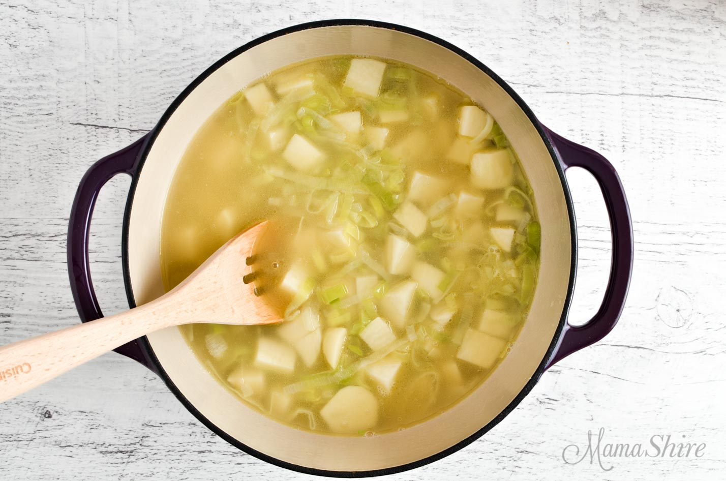 Dutch oven full of dairy-free leek and potato soup.