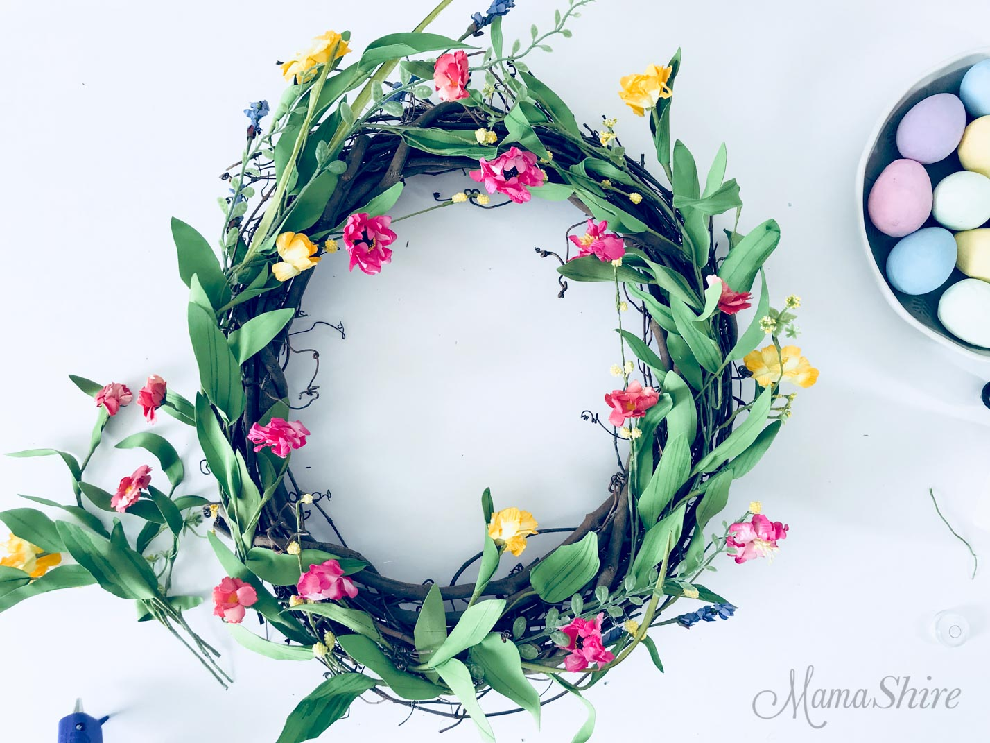 Grapevine wreath with flowers.