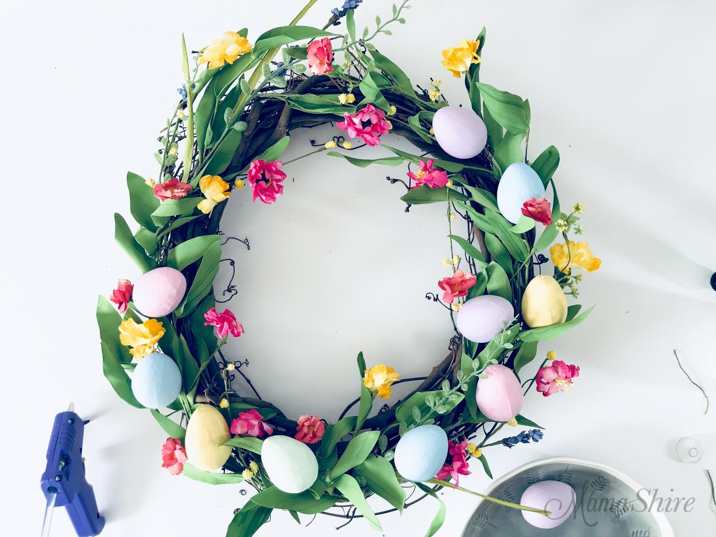 Placing the painted eggs on the Easter Wreath.