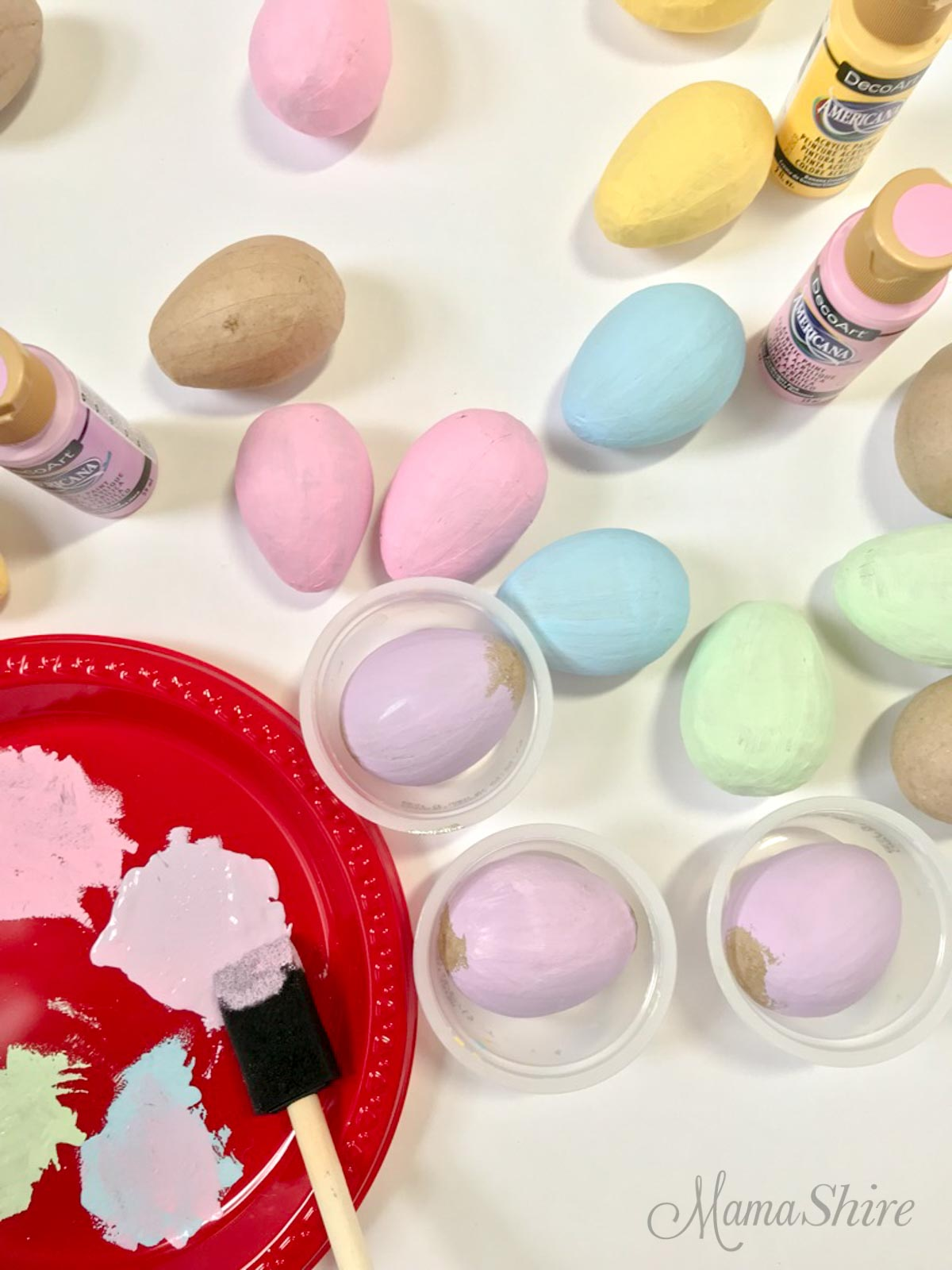 Painted paper mache eggs.