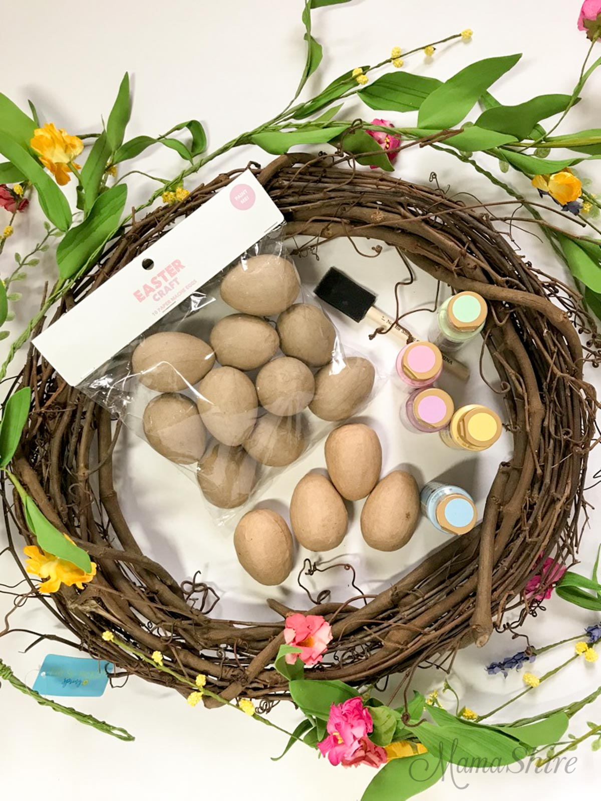 Supplies to make an Easy Easter Egg Wreath. Grapevine wreath, paint, eggs, flowers.