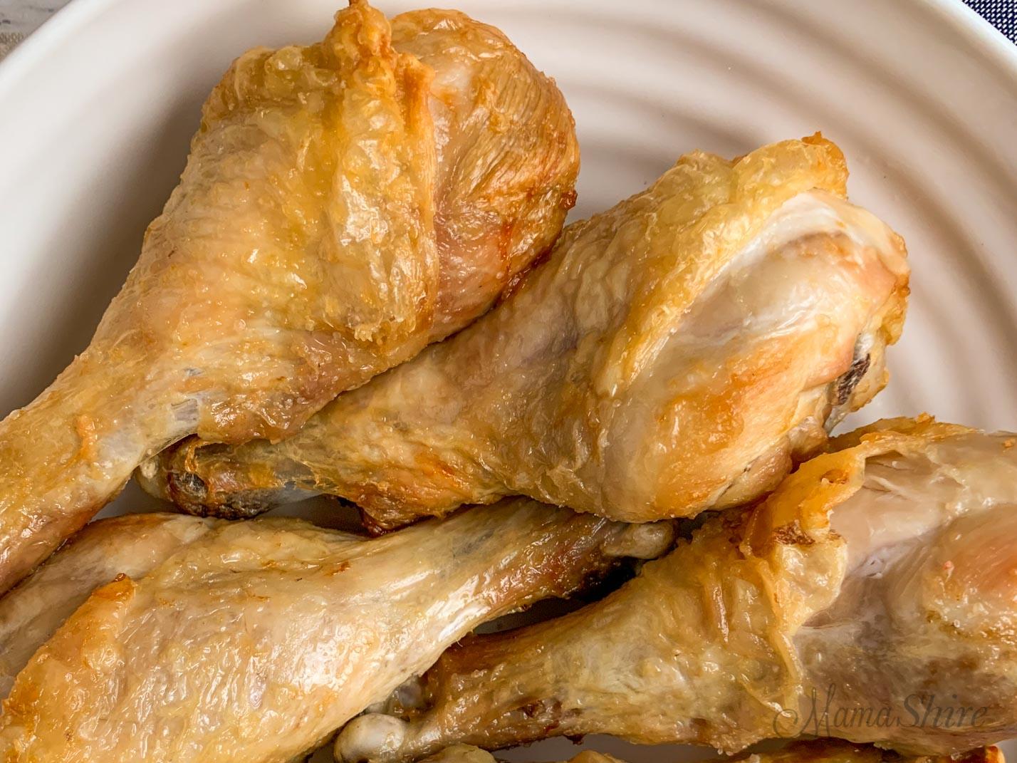 Gluten-free air fryer chicken legs with crispy skin.