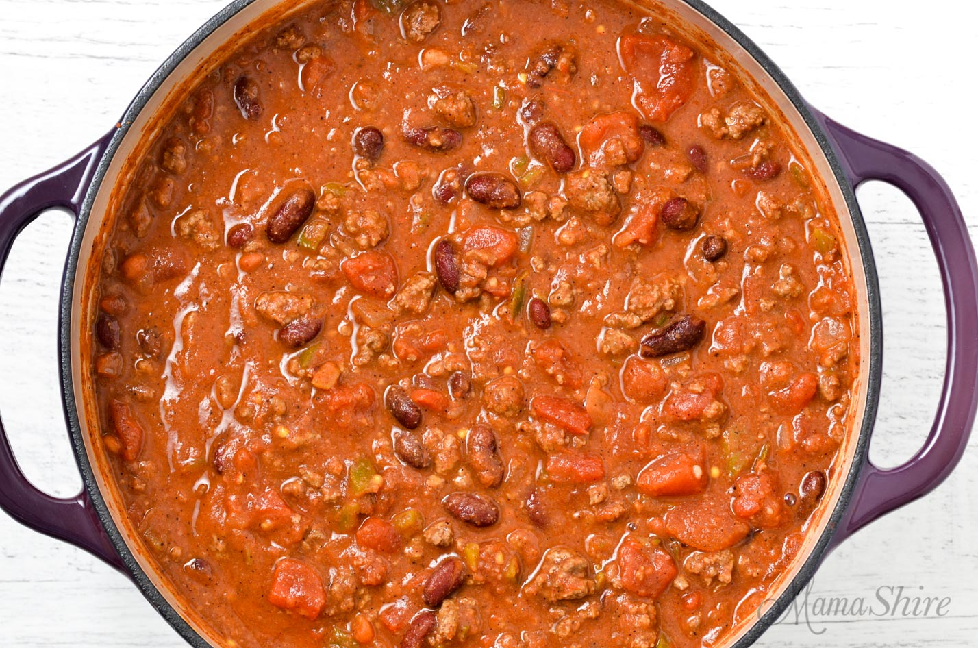A big pot of chili with ground beef, beans, tomatoes, and salsa.