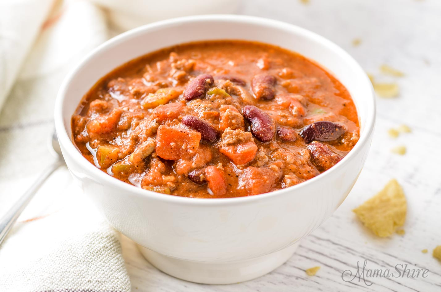 A white bowl full of gluten-free chili.