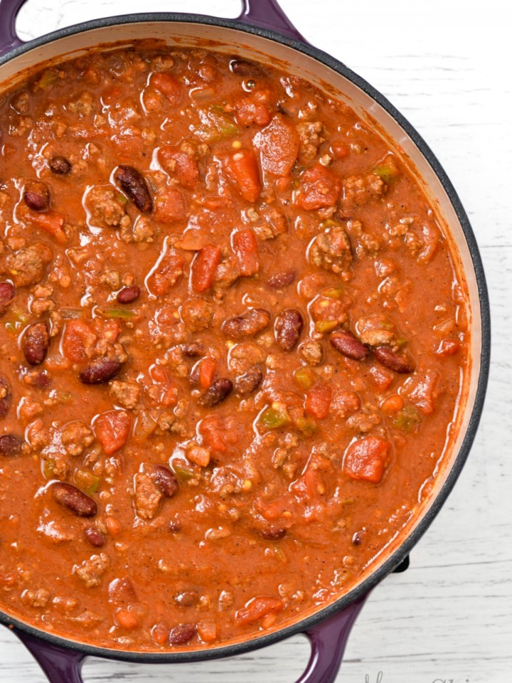 A big pot of gluten-free chili in a purple pot.