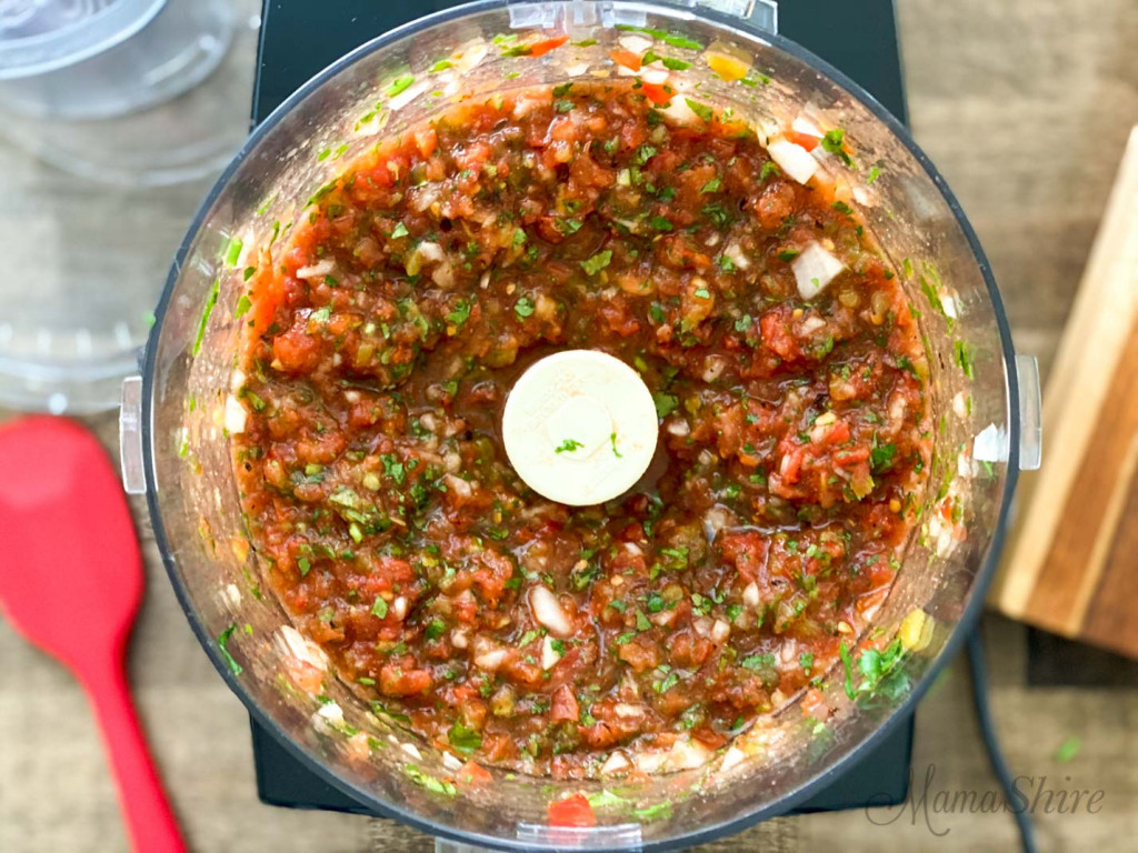 Chopped ingredients in a food processor.