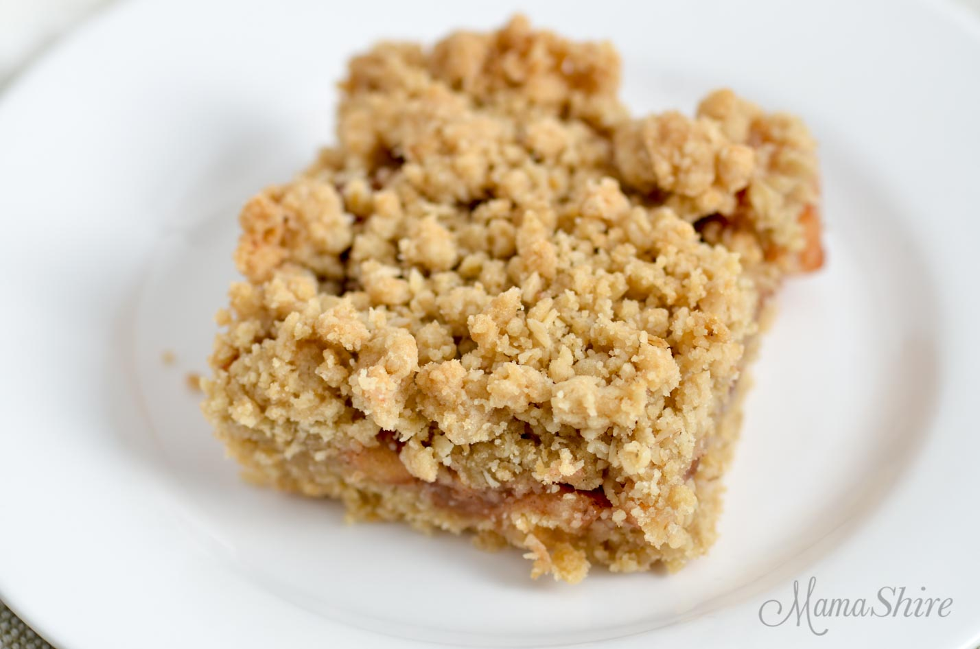 Apple oatmeal bar with crumb topping.