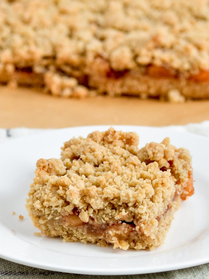 Gluten-free apple cinnamon oatmeal bar with more in the background.