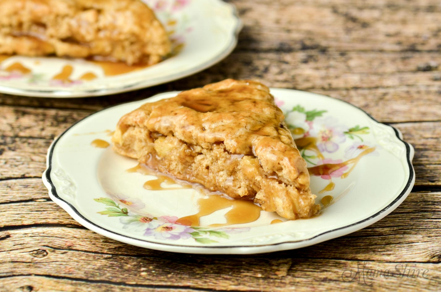 Gluten-free apple cinnamon scones with a drizzle of caramel sauce.