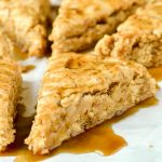 Gluten-free apple cinnamon scones with caramel sauce.