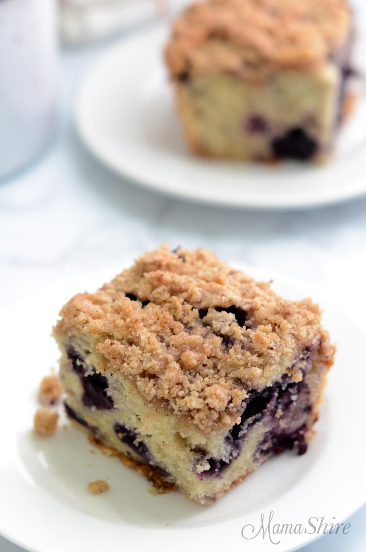 Two servings of gluten-free blueberry coffee cake.