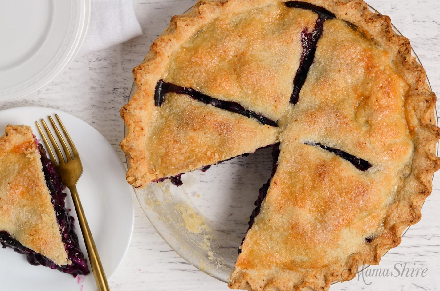 Gluten-Free Blueberry Pie with one slice cut out.