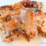 Gluten-free bread pudding with vanilla sauce.