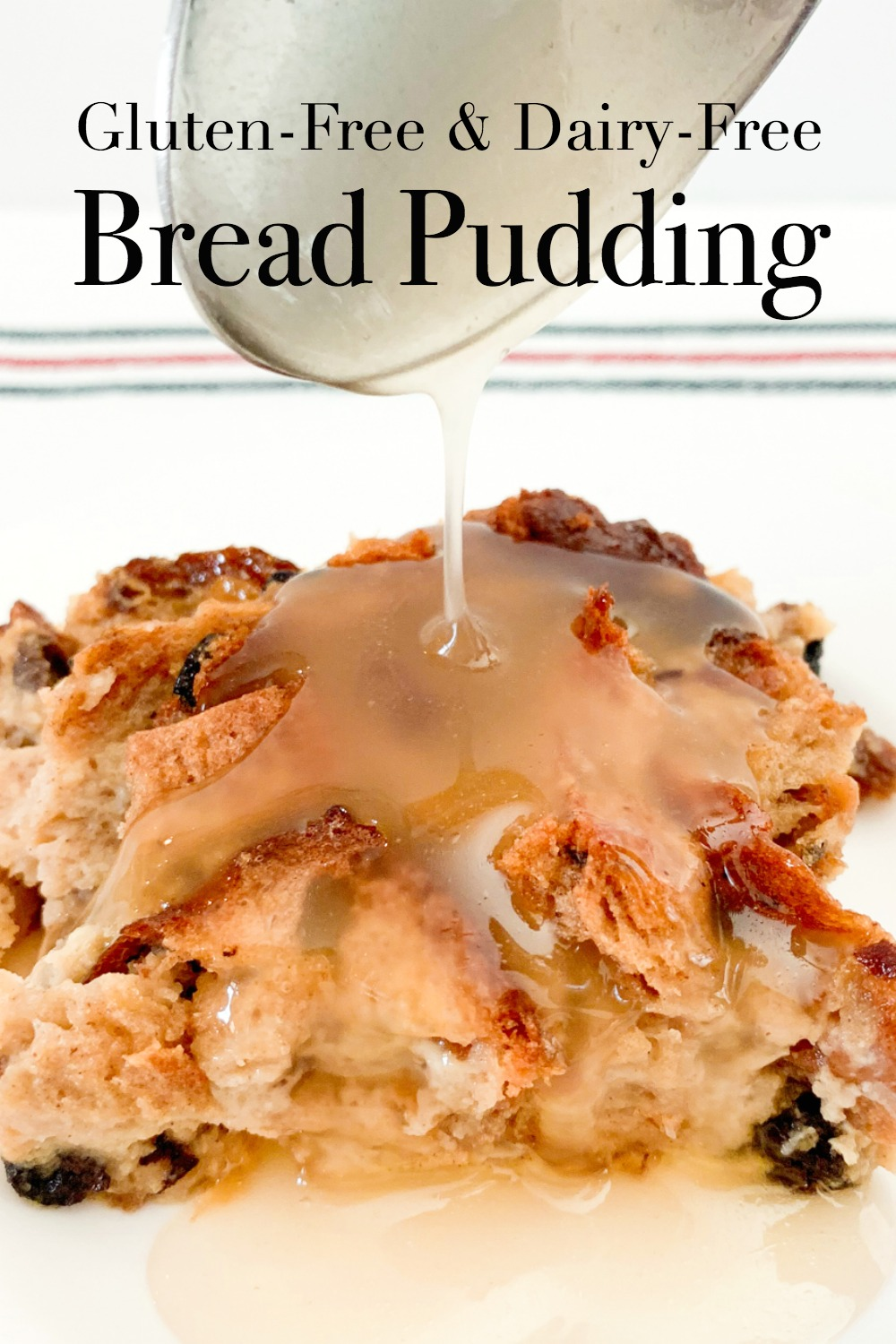 Gluten Free Bread Pudding with a vanilla sauce being drizzled over the top.