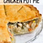 A chicken pot pie with a couple slices removed so you can see the yummy vegetable filling.