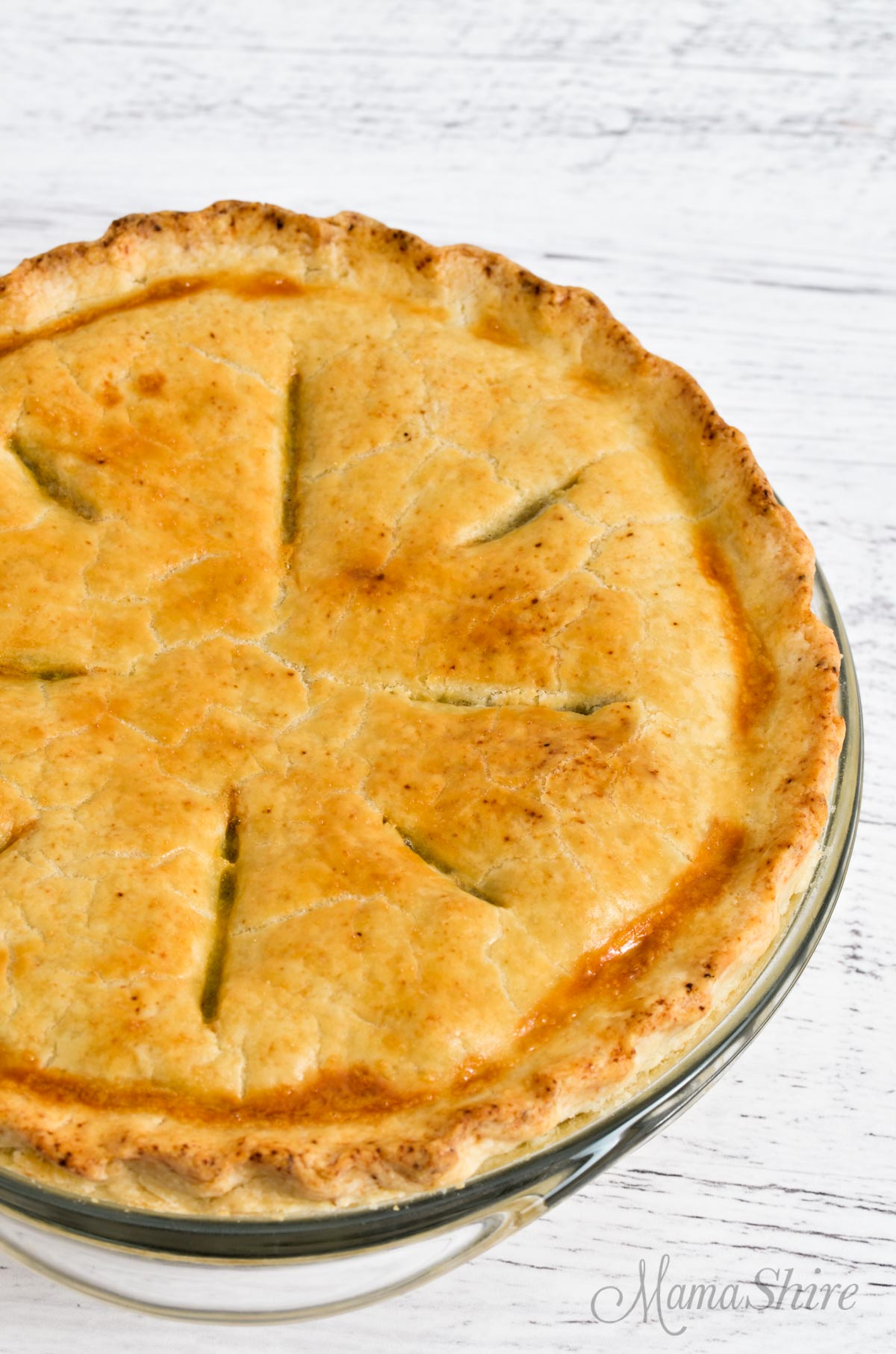 A whole chicken pot pie with a gluten-free homemade pie crust.