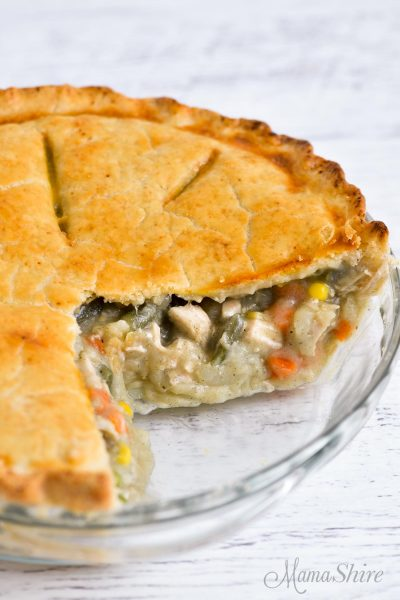 A chicken pot pie with a couple of slices removed.