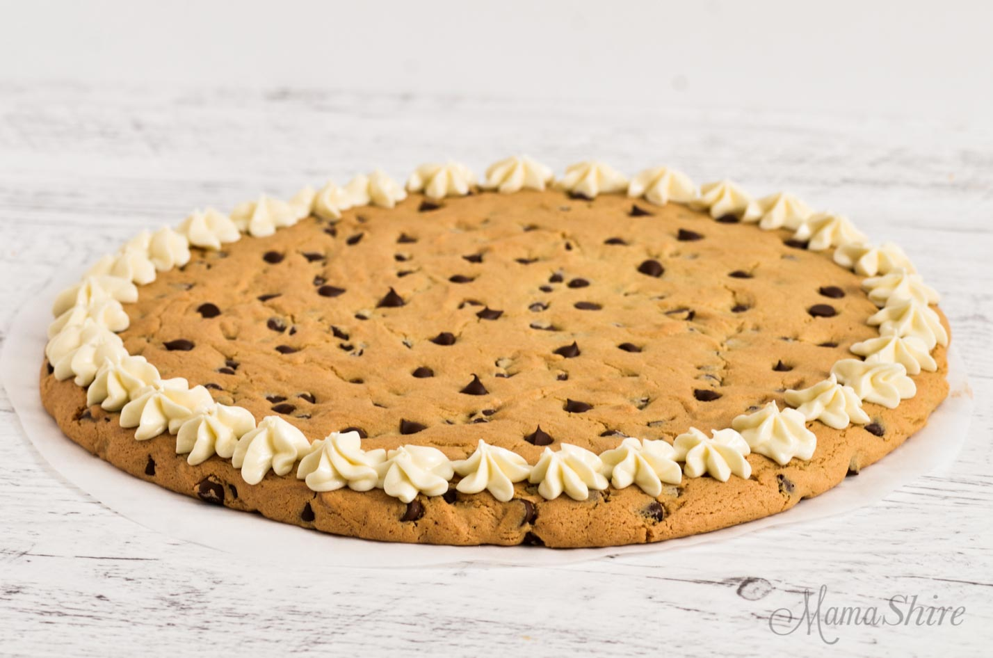 Chocolate chip pizza cookie with icing.